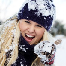 beautiful winter woman with snow